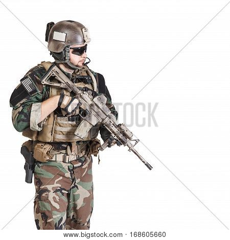 United states Marine Corps special operations command Marsoc raider with weapon. Studio shot of Marine Special Operator white background