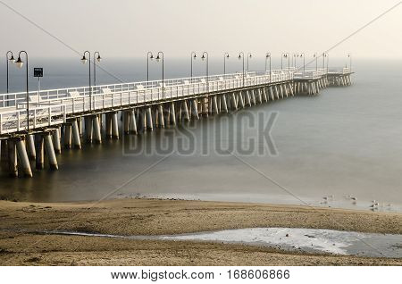baltic sea and pier in gdynia orlowo in poland in wintertime, europe