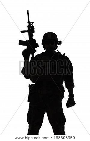 United states Marine Corps special operations command Marsoc raider with weapon. Silhouette of of Marine Special Operator white background