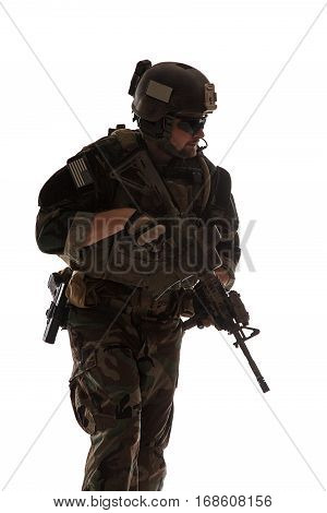 United states Marine Corps special operations command Marsoc raider with weapon. Studio shot of Marine Special Operator white backgroun