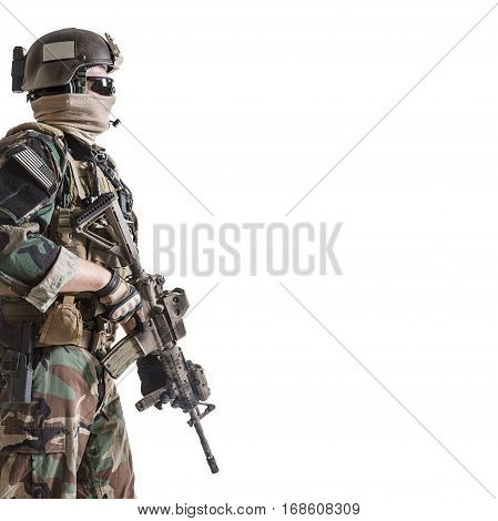 United states Marine Corps special operations command Marsoc raider with weapon. Studio shot of Marine Special Operator white background copyspace