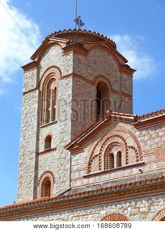 Vertical picture of beautiful tower of Saint Clement Church under vibrant blue sky, Ohrid, Macedonia