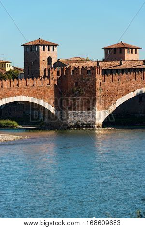 Detail of the ancient Scaligero bridge near Castelvecchio (Old Castle) and Adige river in Verona (UNESCO world heritage site) - Veneto Italy