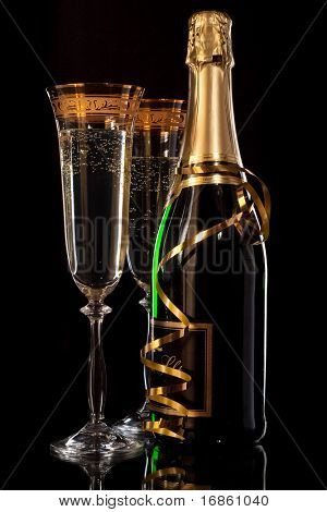 Glasses of champagne with bottles