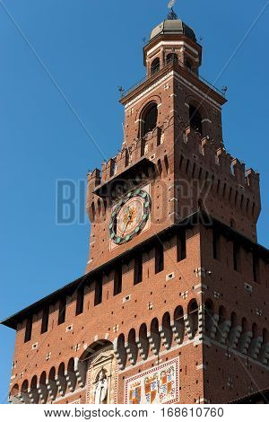 Detail of the tower of Filarete (clock tower) of the Sforza Castle XV century (Castello Sforzesco). It is one of the main symbols of the city of Milan Lombardy Italy