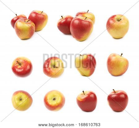 Set of multiple ripe red and golden jonagold apple compositions and foreshortenings, isolated over the white background