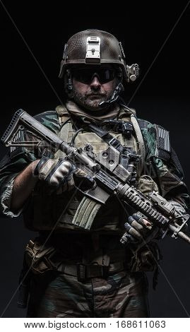 United states Marine Corps special operations command Marsoc raider with weapon. Studio shot of Marine Special Operator black background