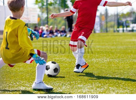 Soccer Goalkeeper Save. Running Football Soccer Player with Ball. Footballer Kicking Football Match on the Pitch. Youth Soccer Goalkeeper Jersey. Young Teen Soccer Game. Youth Sport Background