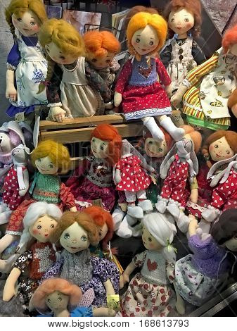 LVIV UKRAINE - FEBRUARY 02: Funny handmade dolls (girls) in a shop window in the centre of Lvov on February 02 2017 in Lviv Ukraine