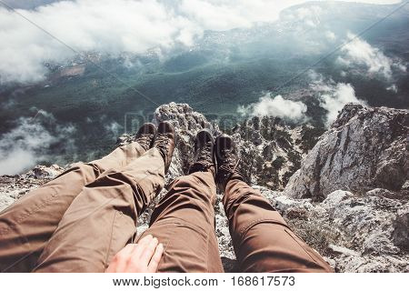 Couple Feet selfie on mountains cliff aerial view relaxing Travel Lifestyle adventure vacations concept into the wild