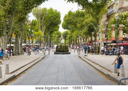 AIX EN PROVENCE,FRANCE-AUGUST 9,2016:People strolling down the typical little square of Aix-en-Provence during a summer day.