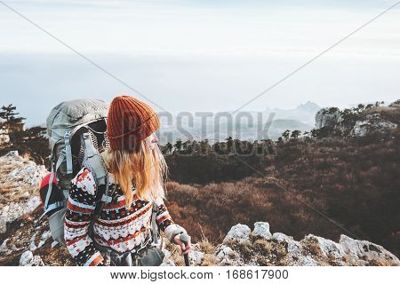 Woman tourist traveling with backpack hiking Travel Lifestyle concept adventure vacations outdoor