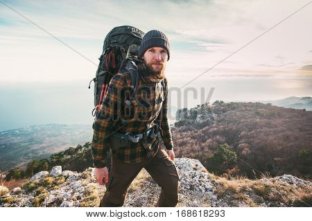 Bearded Man backpacker hiking in mountains Travel Lifestyle concept adventure active vacations outdoor mountaineering sport