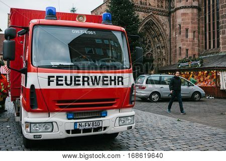 Nuremberg, Germany, December 27, 2016: Fire truck in the historic part of the city on Hauptmarkt square in Nuremberg in Bavaria, Germany.