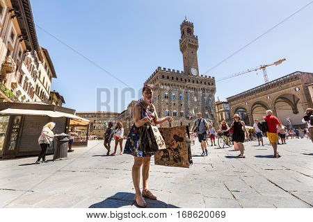 View Of A Girl Shopping In Florence In Italy