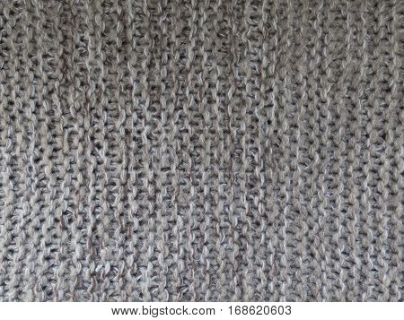 Warm grey background gray wool knitted texture