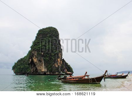 Expansive view of the awesome greenish turquoise Andaman Sea and the scenic golden beach of Railey Bay Krabi Southern Thailand during summer and monsoon season.