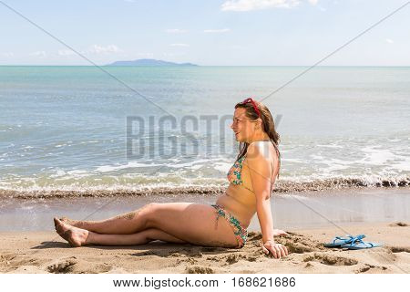 Girl At The Natural Beach Cala Di Forno In Italy