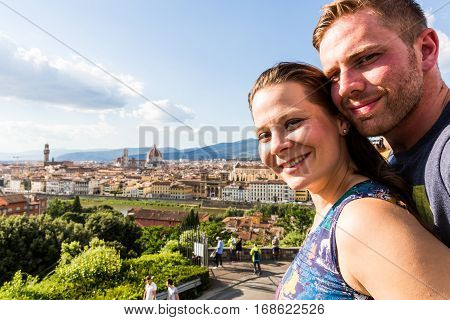 Couple at the Michelangelo Square in Florence Italy in summer 2016