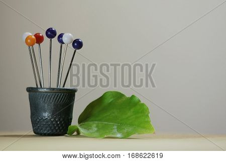 Thimble and pins similar to the a bouquet of flowers in a pot