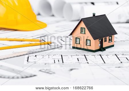 Construction Plans With Drawing Tools House Miniature And Safety Helmet