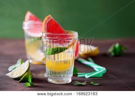 Various citrus infused water in two glasses