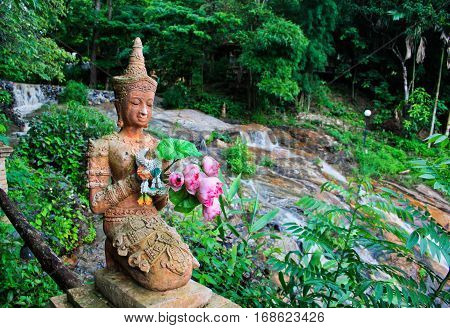 Buddhist statue on the ground of Wat Pha Lat in Chiang Mai, Northern Thailand