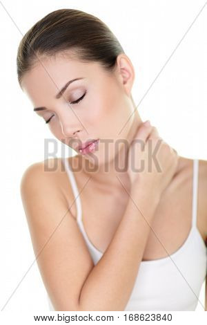 Neck pain problem. Asian woman touching painful back muscles to release tension from stress. Physiotherapy treatment or massage therapy concept.
