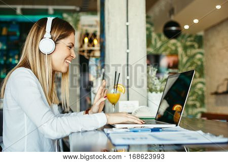 Woman have business meeting via video call in a cafe