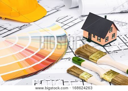 Construction Plans With Whitewashing Tools Colors Palette And Miniature House