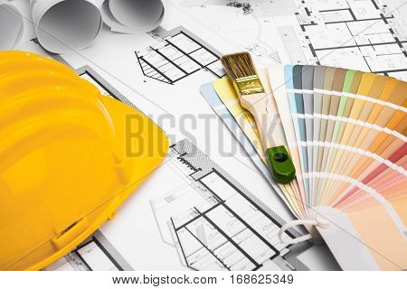 Construction Plans With Paint Brush Colors Palette And Yellow Safety Helmet