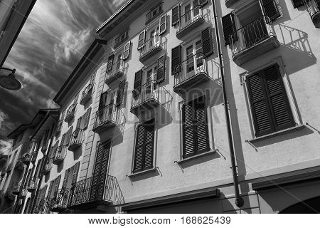 Como (Lombardy Italy): old typical street near the medieval cathedral. Black and white