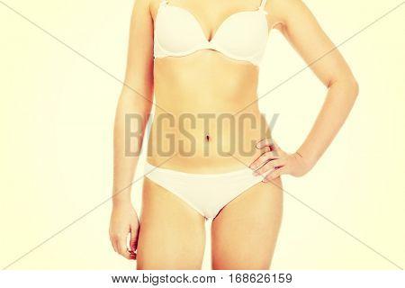 Body of slim woman in white underwear