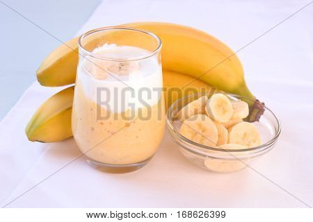 Banana Yogurt smoothie in a glas and banana fruit.