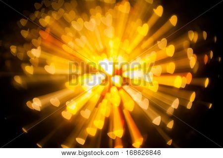 explosion of bokeh heart gold blur background