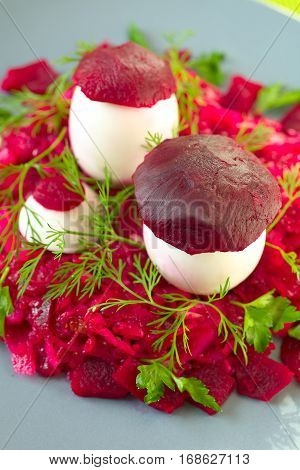 Beetroot salad with funny mushrooms from egg and beetroot