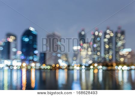 Night blurred bokeh lights office building and reflection abstract background