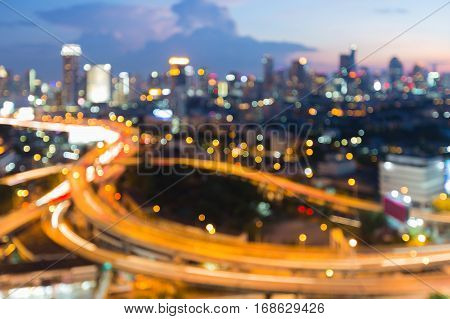 Blurred bokeh light city and interchanged aerial view abstract background