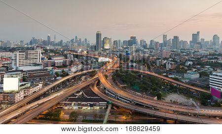 Aerial view City office building with highway intersection long exprosure Bangkok downtown Thailand