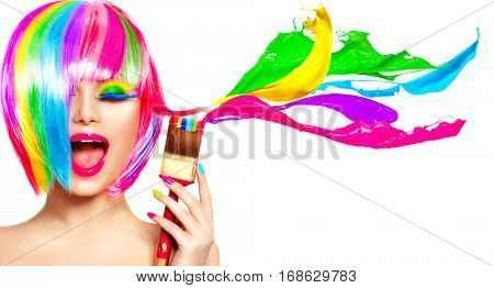 Dyed Hair humor concept. Beauty model woman painting her hair in colourful bright colors. Funny Joyful girl with paint brush and colorful splashes. Isolated on white background