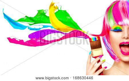 Dyed Hair humor concept. Beauty model woman painting her hair in colourful bright colors. Funny Joyful girl with paint brush and colorful splashes. Isolated on white background. Make up concept.