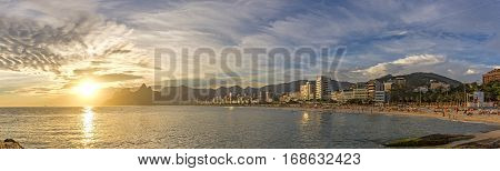 Panoramic landscape of the beaches of Arpoador Ipanema and Leblon in Rio de Janeiro during sunset with sky and the hill Two brothers and Gávea stone in the background