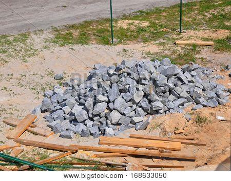 Stones on the Construction Site. Building Materials - Many Hard Sharp Granite Rocks.