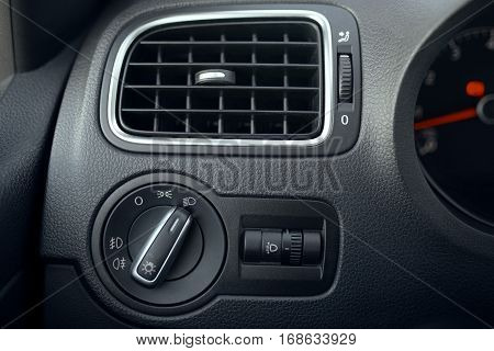 Automotive air conditioning. The flow of air inside the vehicle. headlamp switch. Detail of the interior of the car