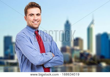 Young businessman outdoor standing against a modern skyline