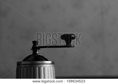 Old handle of grinder coffee, sugar, pepper mill in vintage style