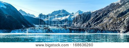 Panoramic view in Glacier Bay from cruise ship cruising towards Johns Hopkins Glacier in summer in Alaska, USA. Banner panorama crop.