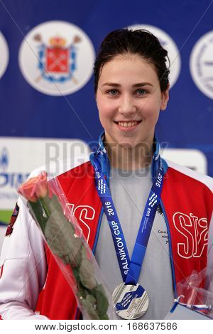 ST. PETERSBURG, RUSSIA - DECEMBER 17, 2016: Silver medalist in women 200 m breaststroke swimming Sofia Andreeva in medal ceremony of X Vladimir Salnikov Cup. Athletes from 6 countries participated