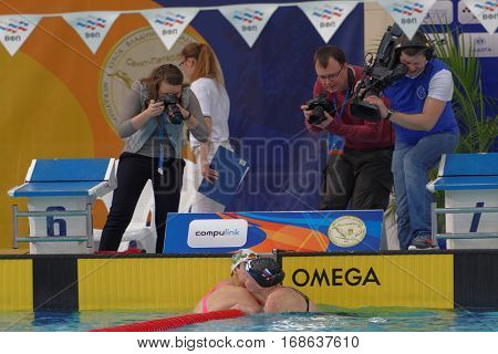 ST. PETERSBURG, RUSSIA - DECEMBER 17, 2016: Winners of women 200 m medley competitions Irina Krivonogova (right) and Anastasia Osipenko after the finish. Athletes from 6 countries participated in cup
