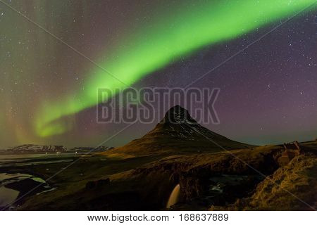 Northern Light over Kirkjufell volcano mountain night view with fully of start on the sky Iceland in winter season